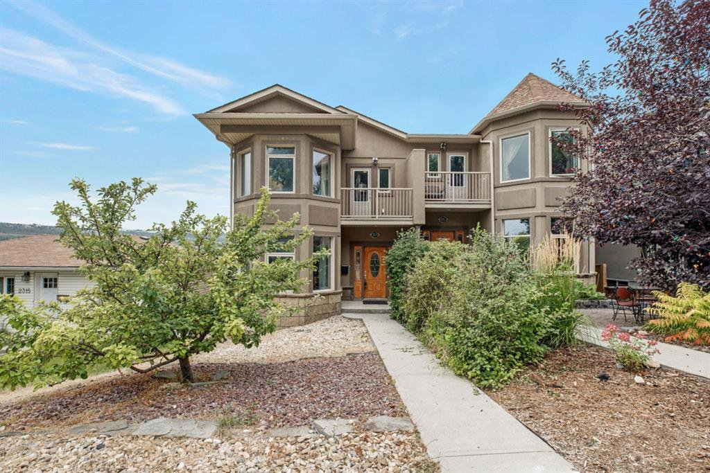 Main Photo: 2319 48 Street NW in Calgary: Montgomery Semi Detached for sale : MLS®# A1034812