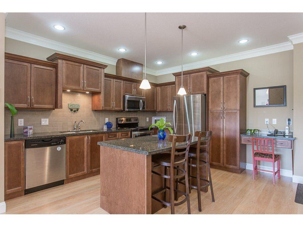 "Main Photo: 408 22150 DEWDNEY TRUNK Road in Maple Ridge: West Central Condo for sale in ""FALCON MANOR"" : MLS®# R2268796"