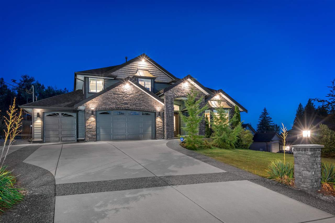 Stunning home on 1 spacious acre, boasting a 3 car garage, plus RV parking