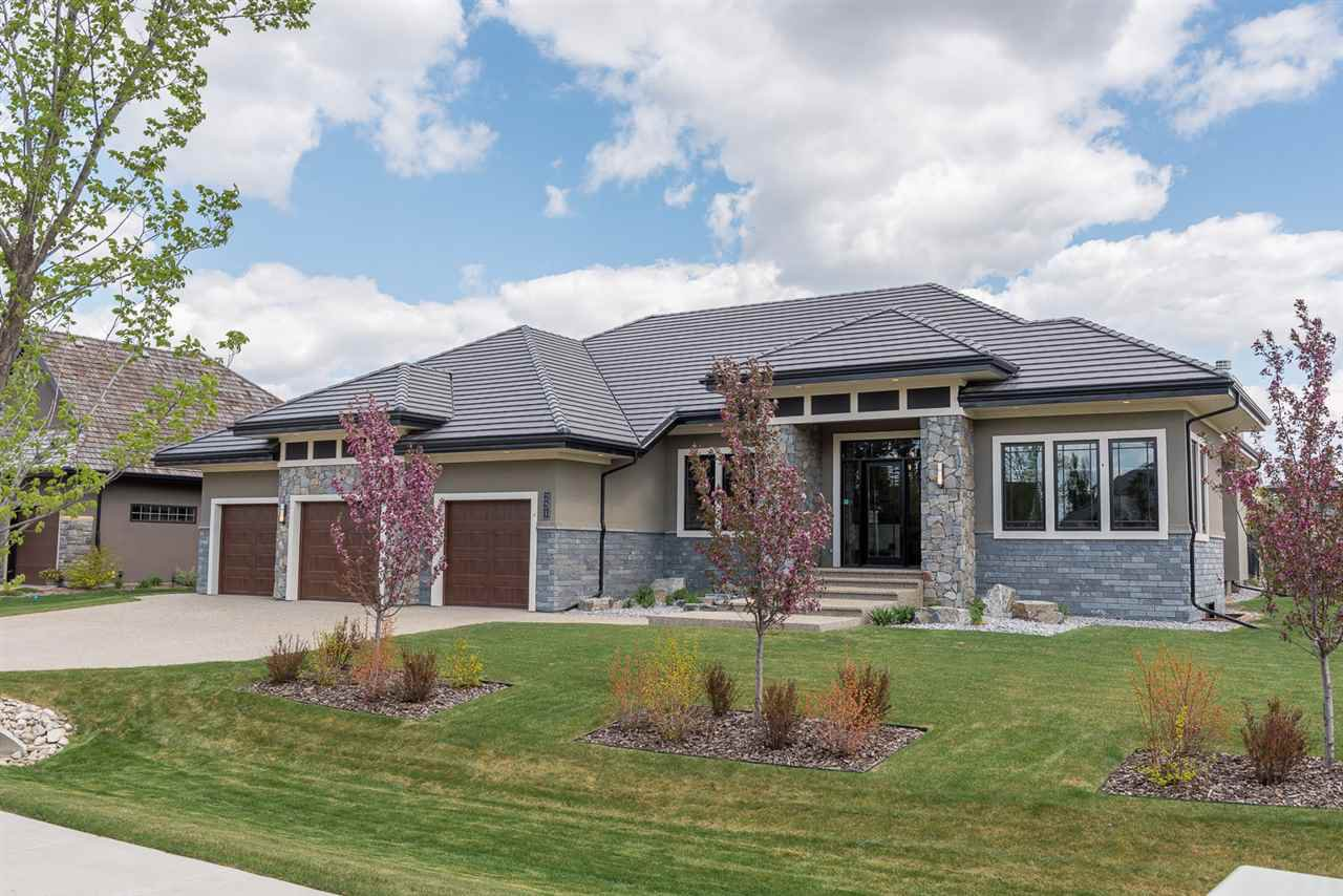 EIFS exterior with concrete tile roof (75 yr life expectancy). Natural stone sourced from BC and NW USA. Exposed aggregate driveway and steps to front entry (extra wide for easy snow removal and barrier free exterior). Security camera at front door.