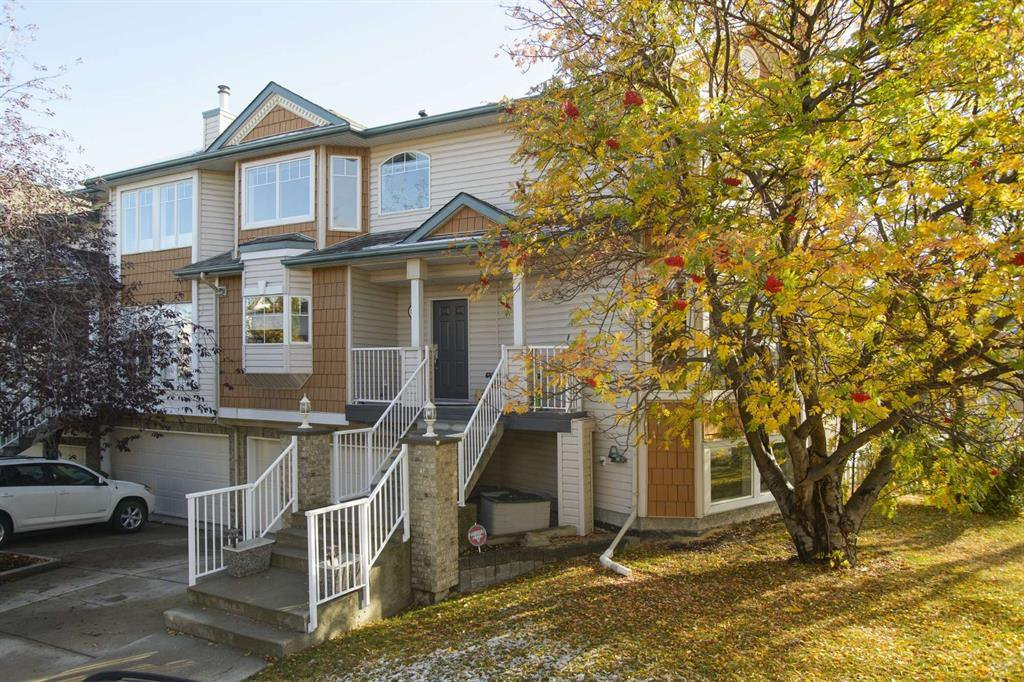 Main Photo: 51 38A Avenue SW in Calgary: Parkhill Row/Townhouse for sale : MLS®# A1043066