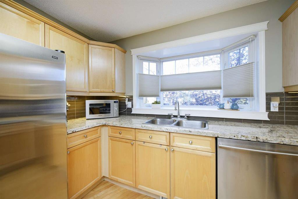 Photo 24: Photos: 51 38A Avenue SW in Calgary: Parkhill Row/Townhouse for sale : MLS®# A1043066