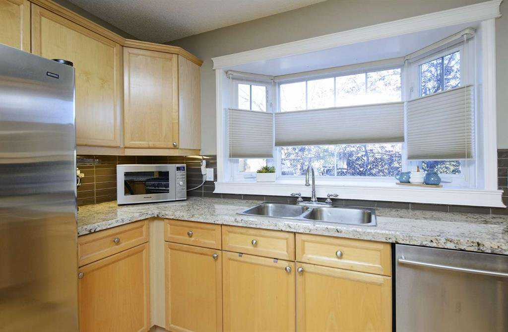 Photo 23: Photos: 51 38A Avenue SW in Calgary: Parkhill Row/Townhouse for sale : MLS®# A1043066