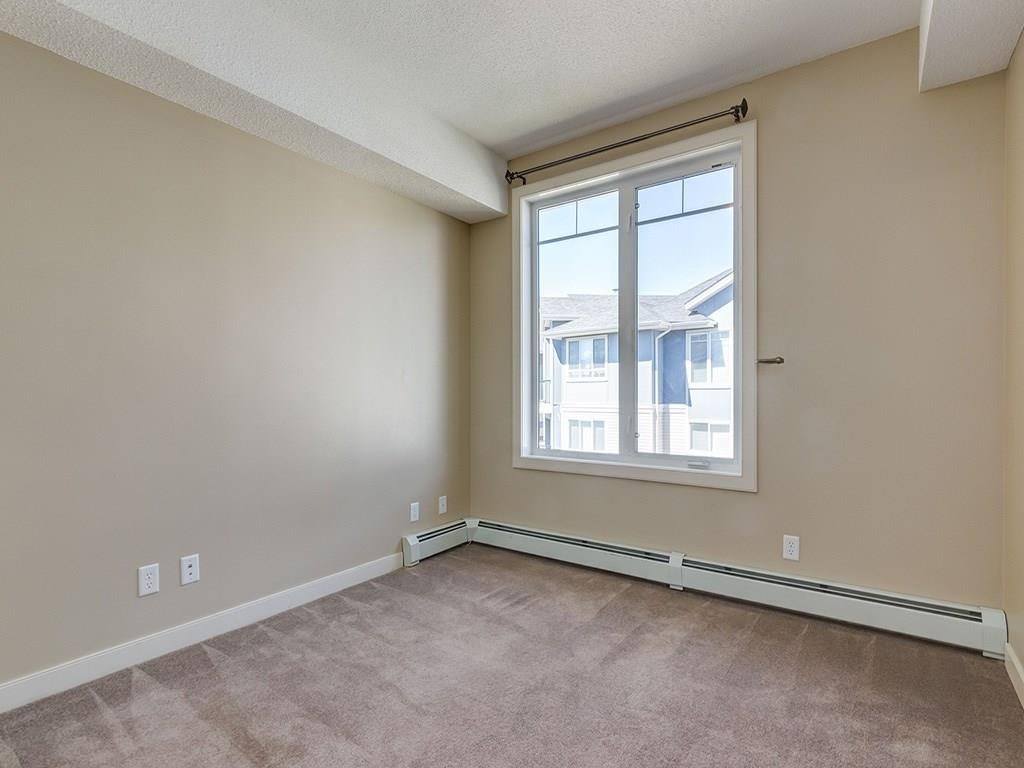 Photo 16: Photos: 403 156 COUNTRY VILLAGE Circle NE in Calgary: Country Hills Village Condo for sale : MLS®# C4120632