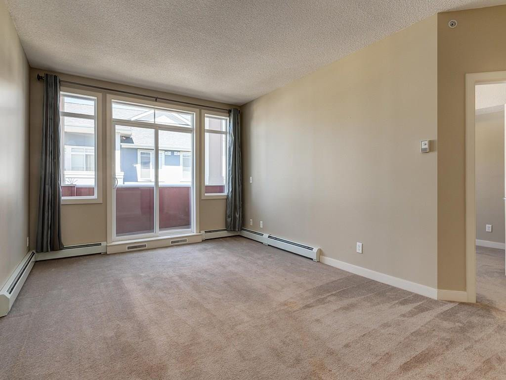 Photo 7: Photos: 403 156 COUNTRY VILLAGE Circle NE in Calgary: Country Hills Village Condo for sale : MLS®# C4120632
