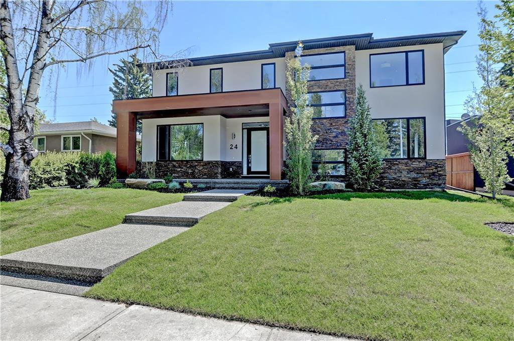 Beautiful curb appeal with aggregate walkway, covered entrance & fully landscaped!