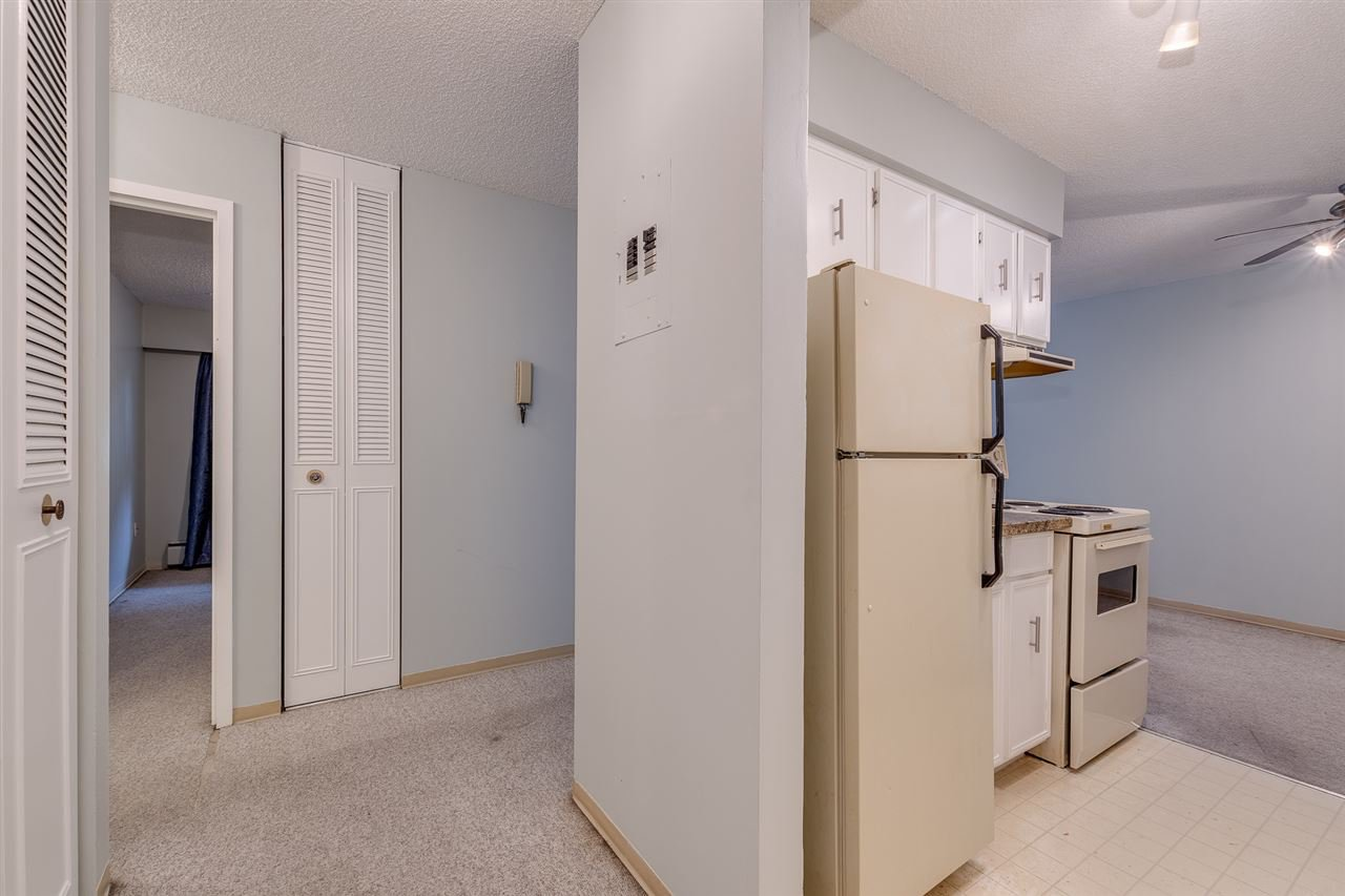 """Photo 4: Photos: 113 5450 EMPIRE Drive in Burnaby: Capitol Hill BN Condo for sale in """"EMPIRE PLACE"""" (Burnaby North)  : MLS®# R2365489"""
