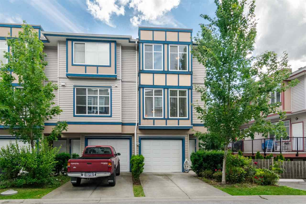"Main Photo: 28 13899 LAUREL Drive in Surrey: Whalley Townhouse for sale in ""Emerald Gardens"" (North Surrey)  : MLS®# R2465107"