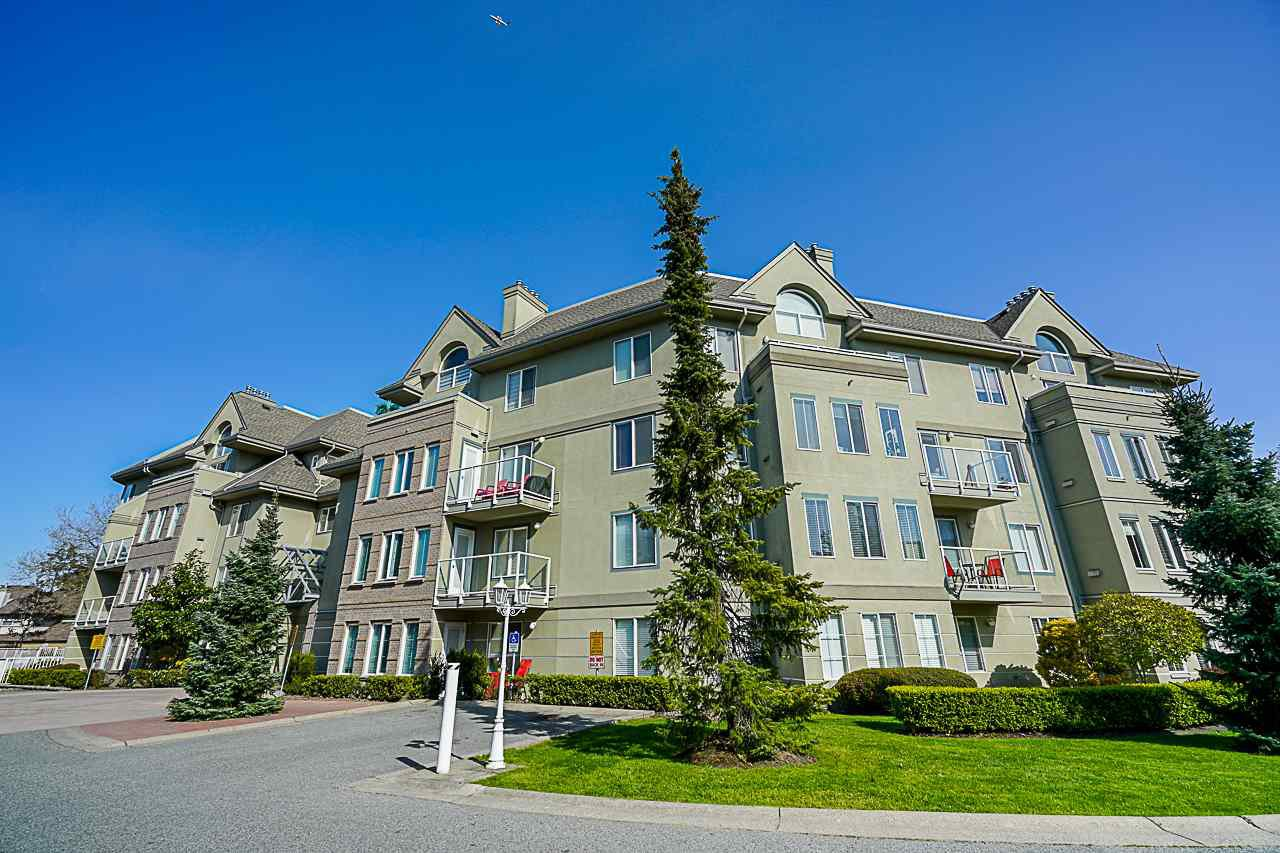 "Main Photo: 103 12125 75A Avenue in Surrey: West Newton Condo for sale in ""Strawberry Hill Estates"" : MLS®# R2366357"