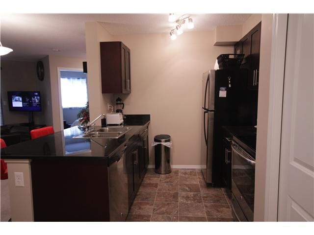 Photo 5: Photos: 215 195 Kincora Glen NW in Calgary: Kincora Condo for sale : MLS®# C3645414