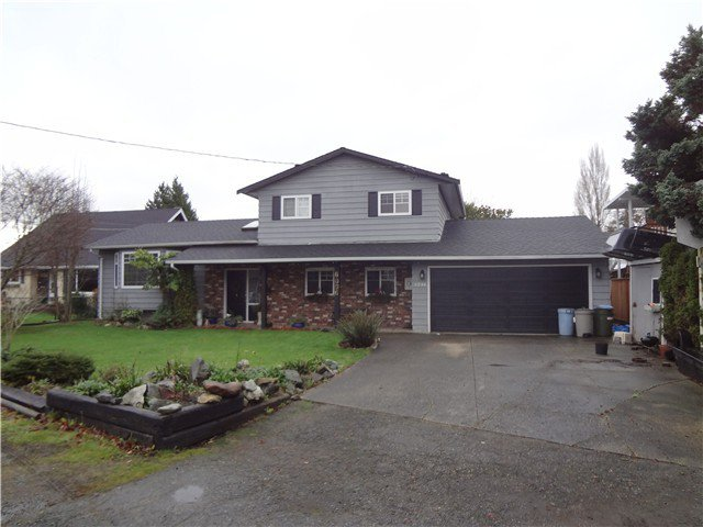 Exterior Front: Located a few doors from a park this lovely 3 level split comes with a new roof and vinyl double paned windows.
