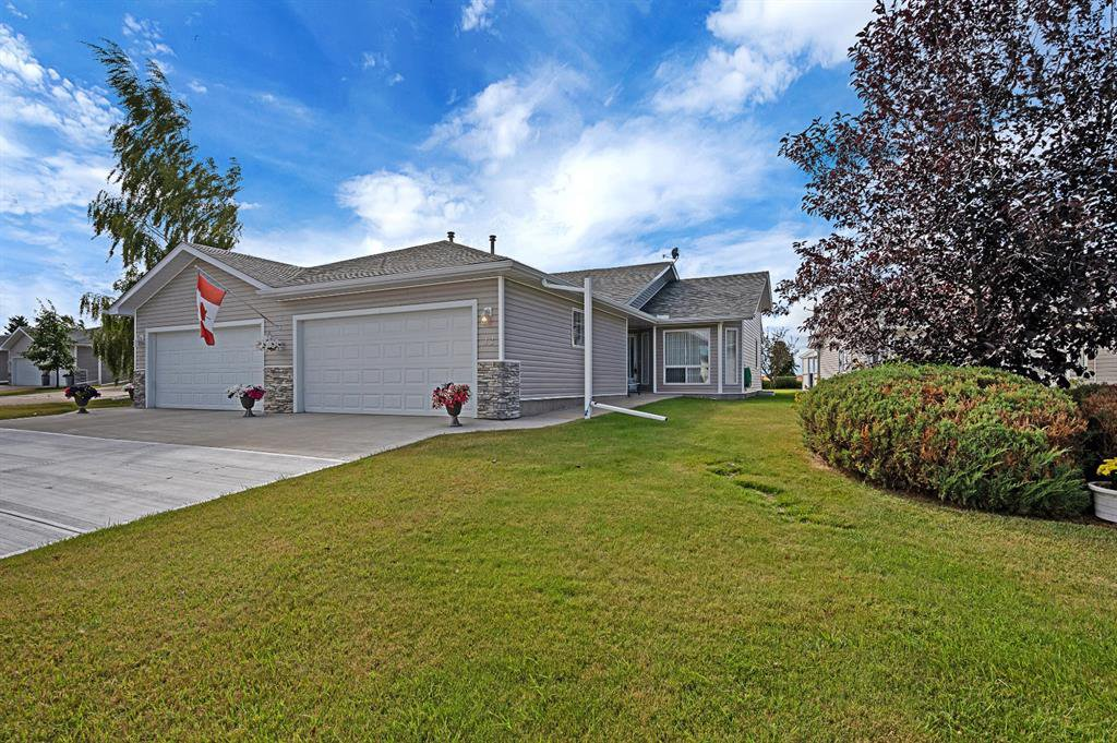 Main Photo: 12 1200 Milt Ford Lane: Carstairs Duplex for sale : MLS®# A1031340