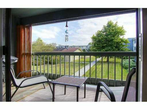 Rare! Open-air balcony with view of peaceful courtyard.