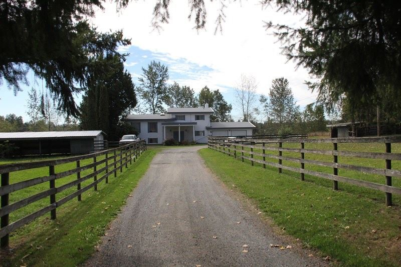 Main Photo: 25062 21B Avenue in Langley: Otter District House for sale : MLS®# R2114213