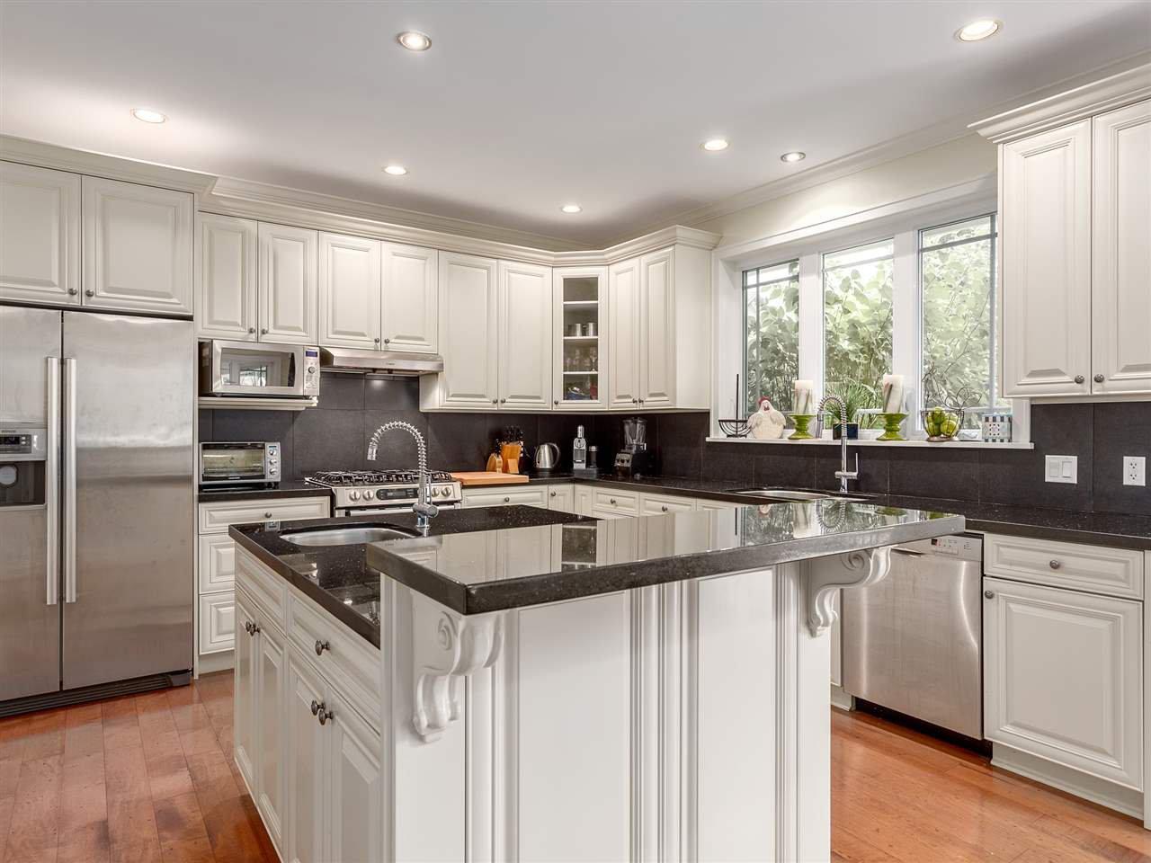 "Main Photo: 1012 CONDOR Place in Squamish: Garibaldi Highlands House for sale in ""Thunderbird Creek"" : MLS®# R2203842"