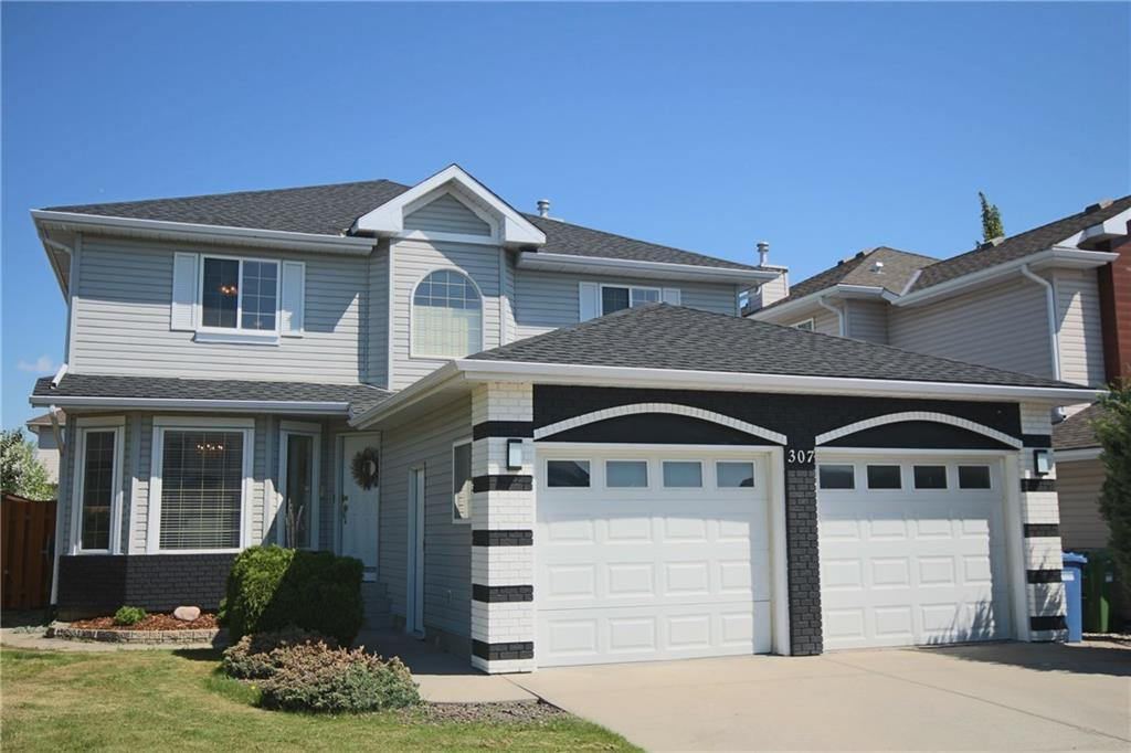 Main Photo: 307 ROCKY RIDGE Cove NW in Calgary: Rocky Ridge Detached for sale : MLS®# C4186420
