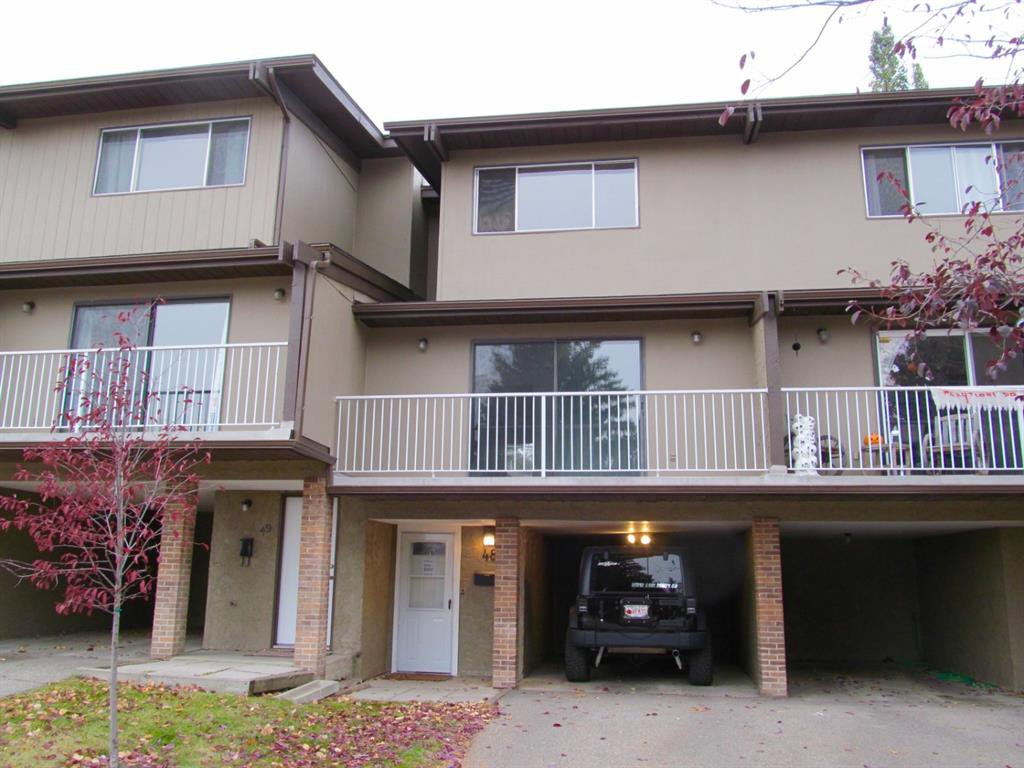 Main Photo: 48 1055 72 Avenue NW in Calgary: Huntington Hills Row/Townhouse for sale : MLS®# A1042900