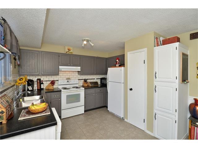 Photo 13: Photos: 10 GLENPATRICK Crescent: Cochrane House for sale : MLS®# C4094257