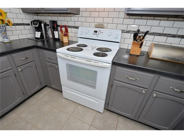Photo 18: Photos: 10 GLENPATRICK Crescent: Cochrane House for sale : MLS®# C4094257