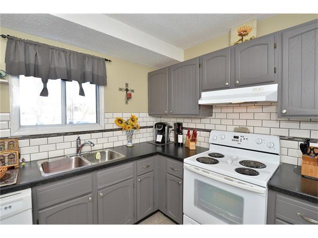 Photo 17: Photos: 10 GLENPATRICK Crescent: Cochrane House for sale : MLS®# C4094257