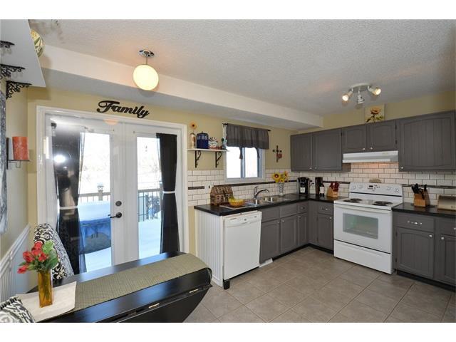 Photo 11: Photos: 10 GLENPATRICK Crescent: Cochrane House for sale : MLS®# C4094257