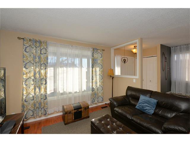 Photo 7: Photos: 10 GLENPATRICK Crescent: Cochrane House for sale : MLS®# C4094257