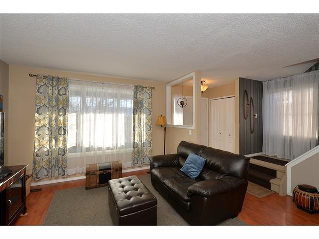 Photo 5: Photos: 10 GLENPATRICK Crescent: Cochrane House for sale : MLS®# C4094257