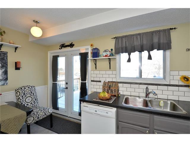 Photo 19: Photos: 10 GLENPATRICK Crescent: Cochrane House for sale : MLS®# C4094257