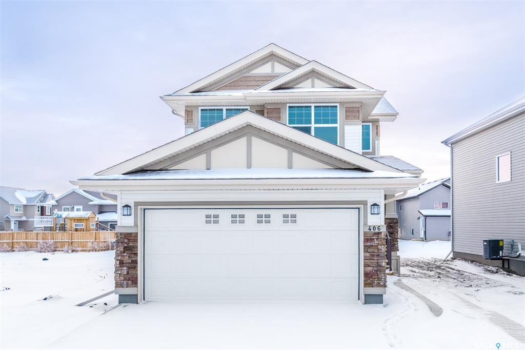Main Photo: 406 Hassard Close in Saskatoon: Kensington Residential for sale : MLS®# SK754921