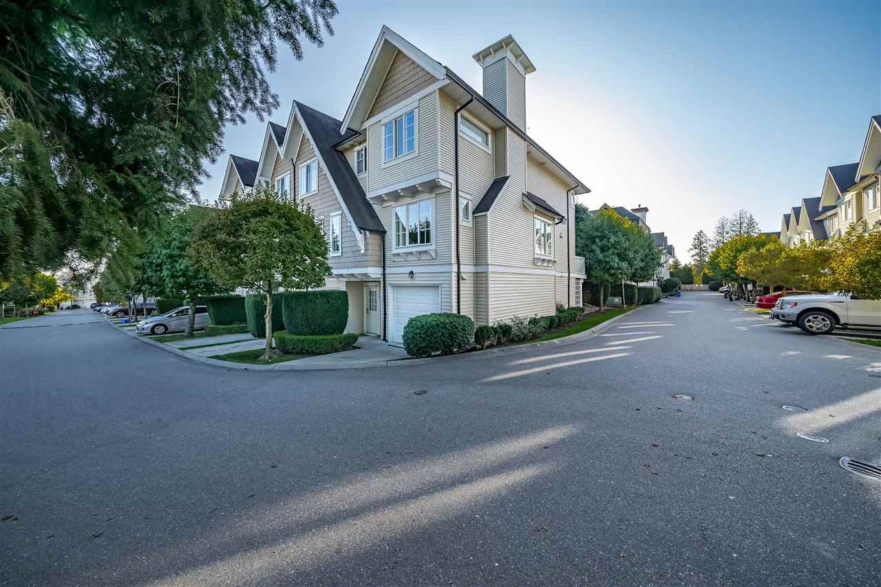 "Main Photo: 101 20540 66 Avenue in Langley: Willoughby Heights Townhouse for sale in ""AMBERLEIGH"" : MLS®# R2428314"