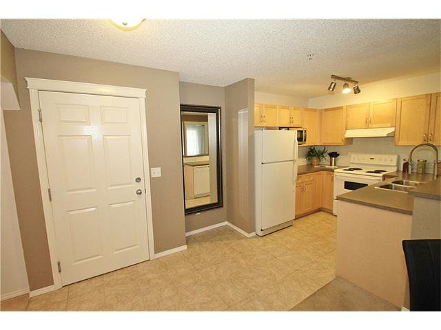Photo 2: Photos: 4210 70 PANAMOUNT Drive NW in Calgary: Panorama Hills Condo for sale : MLS®# C4076260