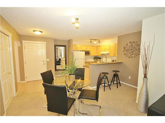 Photo 9: Photos: 4210 70 PANAMOUNT Drive NW in Calgary: Panorama Hills Condo for sale : MLS®# C4076260