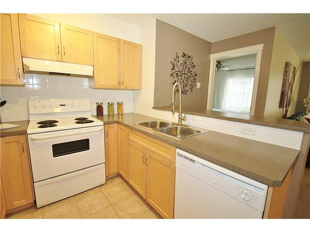 Photo 12: Photos: 4210 70 PANAMOUNT Drive NW in Calgary: Panorama Hills Condo for sale : MLS®# C4076260