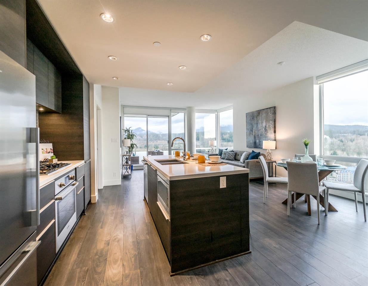Open concept living space with floor-to-ceiling windows that have views from Grouse to Burnaby.