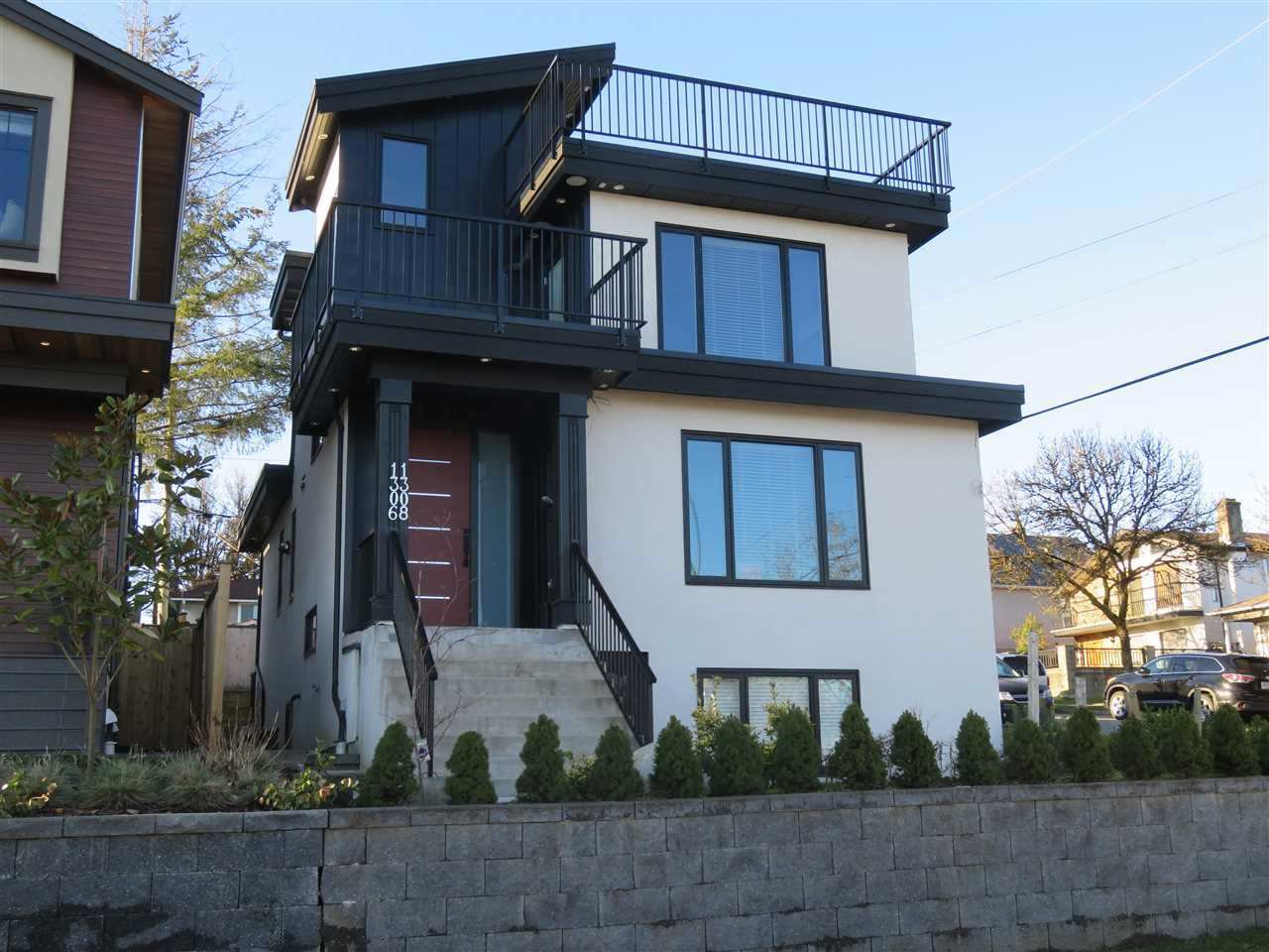 This custom home features 2 levels on basement, plus a laneway house!