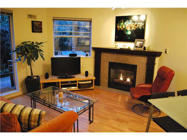 """Main Photo: 103 1959 W 2ND Avenue in Vancouver: Kitsilano Condo for sale in """"CARMEL PLACE"""" (Vancouver West)  : MLS®# V887006"""