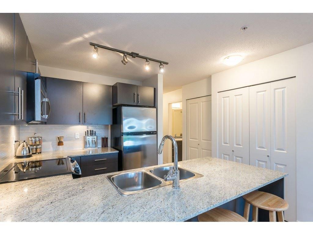 Photo 9: Photos: 404 8915 202 Street in Langley: Walnut Grove Condo for sale : MLS®# R2501980