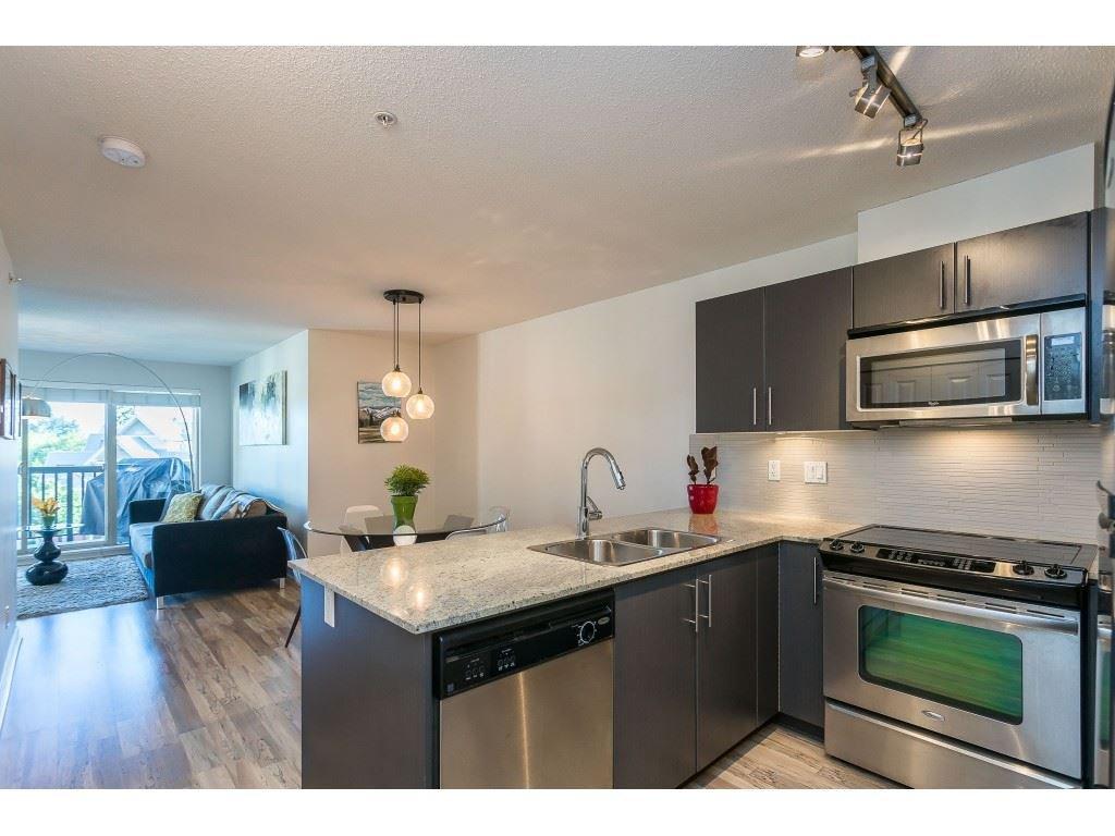 Photo 5: Photos: 404 8915 202 Street in Langley: Walnut Grove Condo for sale : MLS®# R2501980