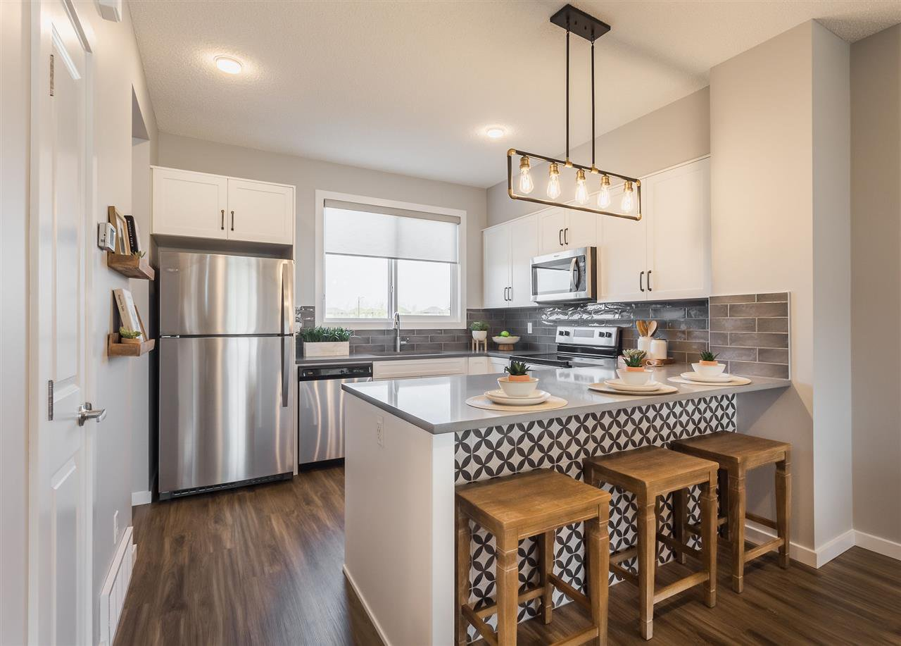 Main Photo: 2141 MAPLE Road in Edmonton: Zone 30 House Half Duplex for sale : MLS®# E4225133