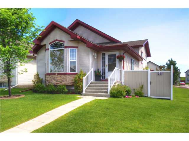 Stunning 4 level split with low maintenance landscaping and fence.