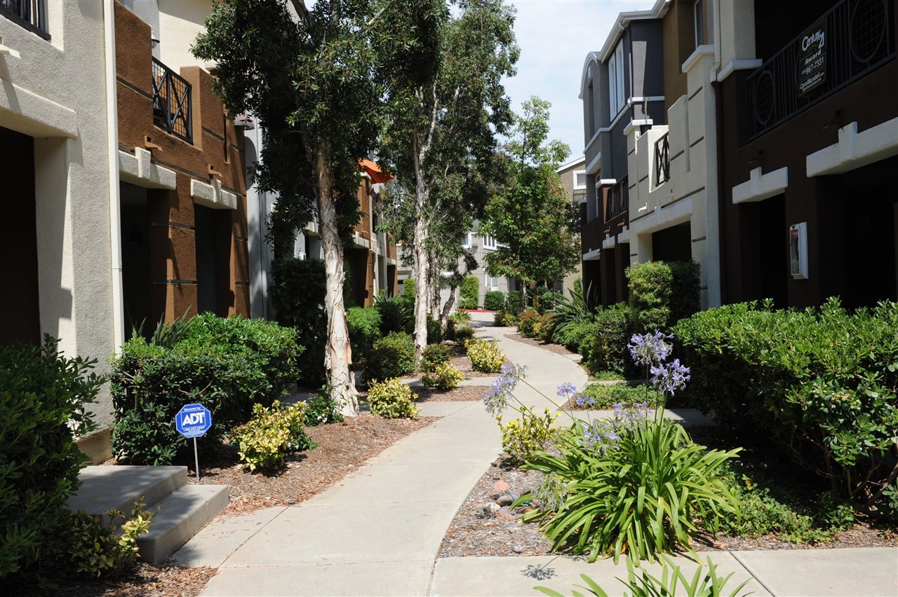 Main Photo: KEARNY MESA Condo for sale : 4 bedrooms : 8755 Plaza Park Lane in San Diego