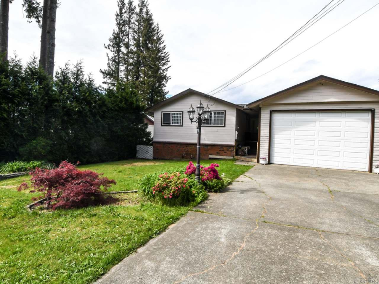 Main Photo: 1234 Denis Rd in CAMPBELL RIVER: CR Campbell River Central House for sale (Campbell River)  : MLS®# 786719