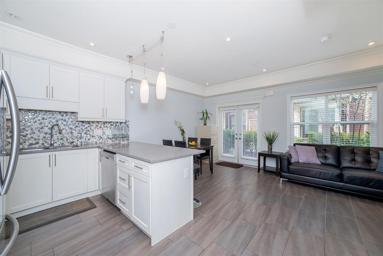 "Photo 3: Photos: 4323 KNIGHT Street in Vancouver: Knight Townhouse for sale in ""Six Homes"" (Vancouver East)  : MLS®# R2250272"