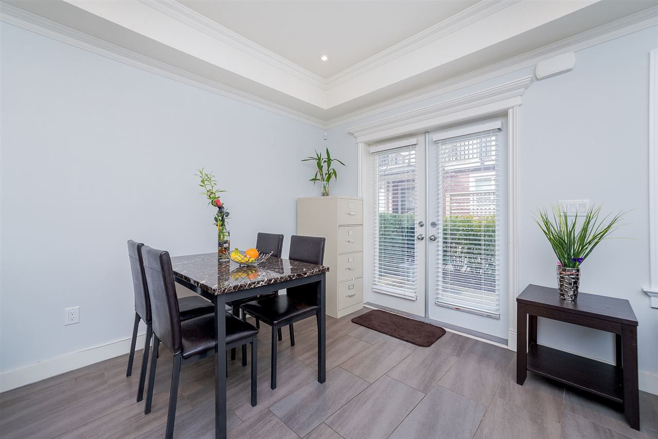 "Photo 6: Photos: 4323 KNIGHT Street in Vancouver: Knight Townhouse for sale in ""Six Homes"" (Vancouver East)  : MLS®# R2250272"