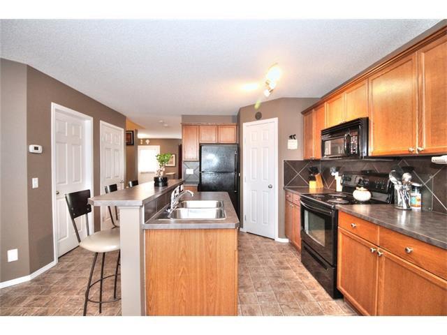 Photo 19: Photos: 710 EVERRIDGE Drive SW in Calgary: Evergreen House for sale : MLS®# C4065103
