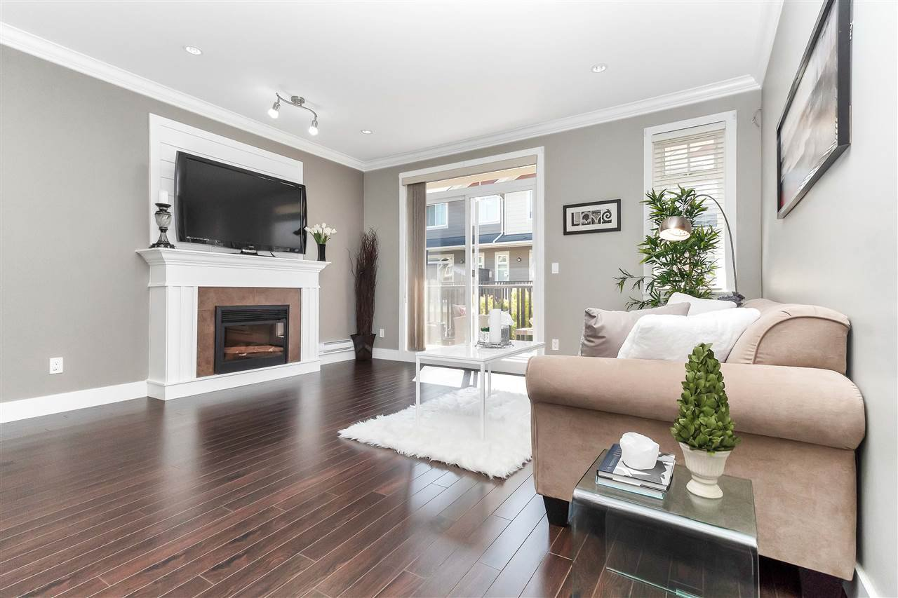 "Main Photo: 75 6383 140 Street in Surrey: Sullivan Station Townhouse for sale in ""PANORAMA WEST VILLAGE"" : MLS®# R2303628"