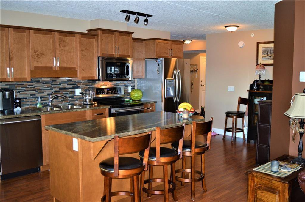 Open concept kitchen,dining and living room....warm and inviting! Maple cabinets, island has deep pot drawers, and check out the upgraded stainless steel appliances!!