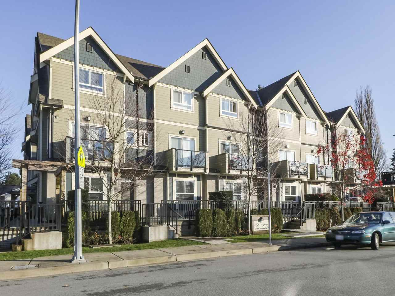 "Main Photo: 209 3488 SEFTON Street in Port Coquitlam: Glenwood PQ Townhouse for sale in ""Sefton Springs"" : MLS®# R2420953"