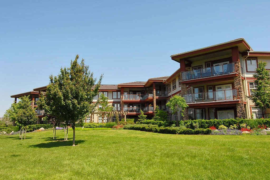 Spacious covered balcony faces southwest and overlooks greenspace and walking paths and a short stroll to shops.