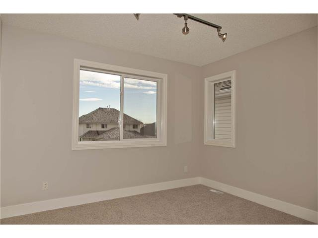 Photo 10: Photos: 115 CHAPARRAL RIDGE Way SE in Calgary: Chaparral House for sale : MLS®# C4033795